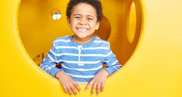 happy-boy-playing-in-play-area-LZR749P.jpg